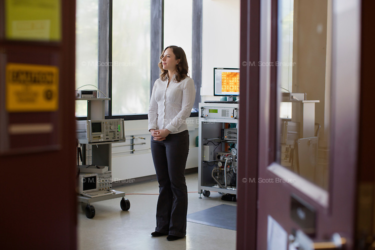Graduate student Laura Popa (pictured) and Associate Professor Dana Weinstein have developed a Gallium Nitride Millimeter Wave Integrade Circuit (MMIC) in the Microsystems Technology Laboratories in the Department of Electrical Engineering and Computer Science at MIT in Cambridge, Massachusetts, USA.  The chip they developed allows fast switching between frequencies in communications technology such as cell phones.
