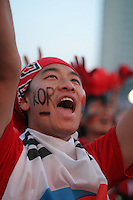 An South Korean National Soccer Team fan cheers while watching Korea's FIFA World Cup first round match against France at the Fan Festival in downtown Leipzig, Germany on Sunday, June 18th, 2006. The teams drew 1-1.