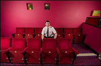 BNPS.co.uk (01202 558833)<br /> Pic: PhilYeomans/BNPS<br /> <br /> Andy even bought his favourite seat from his local ABC an installed it in the back row of his new cinema.<br /> <br /> Field of Dreams....<br /> <br /> Film buff Andy Jones has built an ABC cinema in his back garden as a lasting tribute to the now defunct movie company.<br /> <br /> Andy, 38, has taken four and a half years and spent &pound;70,000 of his life savings building the 34-seat cinema from scratch.<br /> <br /> The father-of-two's movie house mirrors cinemas of the 1930s with big red curtains, red seats and a parquet floor in the projection room. <br /> <br /> The brick building, which is adorned with an ABC sign, is 40ft tall, 22ft wide and 20ft high and takes up half of the garden of his three bed semi-detached house.<br /> <br /> The theatre, which has a 17ft by 7ft screen, has its own projection room, black and white old-style toilets and a foyer with a concessions stand that offers popcorn and sweets.