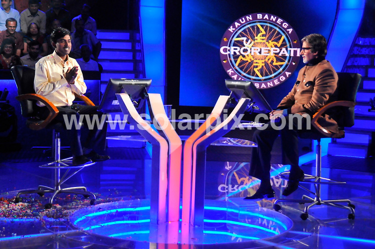 "**ALL ROUND PICTURES FROM SOLARPIX.COM**                                             **WORLDWIDE SYNDICATION RIGHTS**                                                                                  In an astonishing real life version of the plot of the 2008 Oscar-winning film Slumdog Millionaire, whose impoverished hero from a tough neighbourhood of the Indian commercial capital Mumbai wins the biggest prize on a TV quiz show, 27-year-old Sushil Kumar answered a final question correctly to take the jackpot of the massively popular local edition of Who Wants to Be a Millionaire?.""We can't believe it. The whole village have come to our house. We are worried that my dad will die of happiness,"" Sunil Kumar Patel, the winner's brother, told the Guardian. ""We can't speak to Sushil. His mobile is off because he is out with the stars and on and off planes."".Kumar, who has a master's degree in psychology from a local college, wept when the Indian movie legend Amitabh Bachchan, the show's host, handed him a cheque for 50 million rupees after the contestant gave all the right answers in the show's final round..This pic:   Sushil Kumar & Amitabh Bachchan                                                                                           JOB REF:    14176    SJA       DATE:  11.11.11                                                          **MUST CREDIT SOLARPIX.COM OR DOUBLE FEE WILL BE CHARGED**                                                                      **MUST AGREE FEE BEFORE ONLINE USAGE**                               **CALL US ON: +34 952 811 768 or LOW RATE FROM UK 0844 617 7637**"