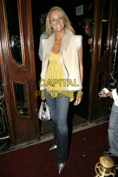 SARAH BOSNICH.Dunes VIP club relaunch party, Kensington Church Street,.London, November 25th 2004..full length white fur suede gilet yellowfloaty top jeans silver bag shoes.Ref: AH.www.capitalpictures.com.sales@capitalpictures.com.©Capital Pictures.