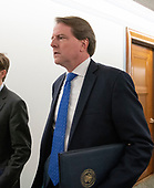 White House Counsel Don McGahn walks in the hallway prior to Judge Brett Kavanaugh giving testimony to refute the words of Dr. Christine Blasey Ford who testified on Kavanaugh's nomination  to be Associate Justice of the US Supreme Court to replace the retiring Justice Anthony Kennedy on Capitol Hill in Washington, DC on Thursday, September 27, 2018.<br /> Credit: Ron Sachs / CNP<br /> (RESTRICTION: NO New York or New Jersey Newspapers or newspapers within a 75 mile radius of New York City)
