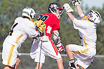Palos Verdes, CA 03/30/10 - Michael Gurunlian (Peninsula #1), Jin Matsumoto (Peninsula #14) and Christian Bender (Palos Verdes #28) in action during the Palos Verdes-Peninsula Varsity CIF Boys lacrosse game at Peninsula HS.