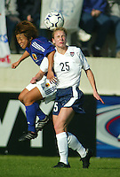 Lindsay Tarpley heads the ball during a 0-0 tie with Japan in San Diego, Calif.,  January 12, 2003.