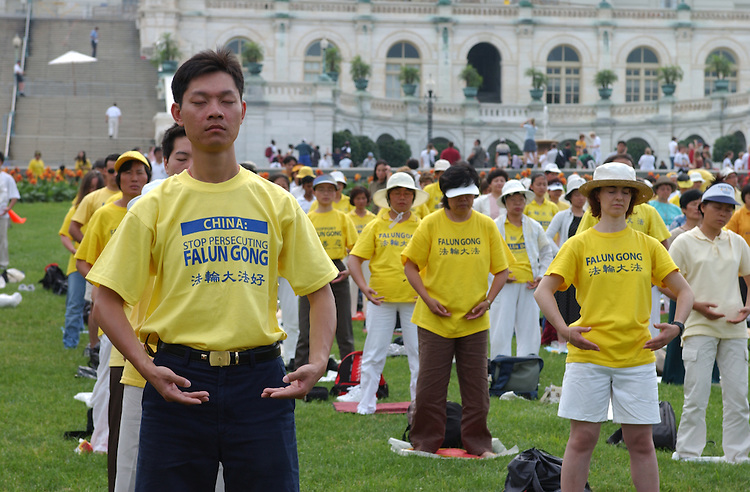 FalunGong1_072203 -- Falun Gong practitioners during a rally to commemorate the fourth anniversary of China's persecution against Falun Gong. The rally was held on the West Front of the U.S. Capitol..