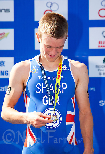 09 SEP 2011 - BEIJING, CHN - Great Britain's Matt Sharp (GBR) studies his winners medal during the presentation ceremony for the Under 23 Men's 2011 ITU World Triathlon Championships .(PHOTO (C) NIGEL FARROW)