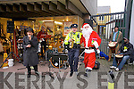 DECK THE MALL: Local Gardai held a charity concert in aid of the Kerry branch of the Irish Kidney Association on Tuesday around the Mall, in Tralee and having fun in photo are Christy McCarthy, Garda Dave Rath and Santa Claus aka Jerry Quinlan.