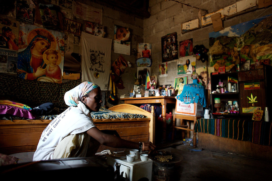 Z. H.. 32 years old prepares coffee in her small one bedroom house in Shashamane, a village that hosts more than 300 Rastafarians Families, in Ethiopia on Wednesday March 19 2008.///..Z.H., who lives with her 16 years old daughter J. lost her husband during the last war between Ethiopia and Eritrea. Members of the Twelve tribes of Israel, a Rastafarian organization present in the village, have donated what once was their garage for her to live in. Her only source of income comes from small seamstress works for the Rasta community. Always a Christian Orthodox, she converted to Rastafarianism in 1998 when she lost her husband and returned to Shashamane..The Rastafarians, who are mainly from Jamaica, started migrating to Ethiopia 45 years ago, when Haile Selassie, whom they consider to be God incarnate, gave them 500 hectares of land on which to settle..Since the first 12 Jamaican settlers in 1963, the community has grown to over 200 families..The Rastafarian community insists that a mass exodus of Jamaicans to Ethiopia would not be a burden, despite the poverty and economic difficulties faced in the country..Some of them are skilled tradesmen such as carpenters and builders..Others are shop owners and they say that over the decades they have played an important role in the development of Shashamene..In January 2005 there were reports in the media that Bob marley's remains were to be exhumed and then reburied at Shashamane. His wife Rita Marley described Ethiopia as his spiritual home, provoking controversy in Jamaica, where his remains lie..At the beginning of the following month, thousands of fans gathered in Shashamane for a month of celebrations for what would have been Marley's 60th birthday. Until 2005 his birthday celebrations were always held in Jamaica. These events brought Shashamane to wider prominence throughout the world..NAMES OF SUBJECTS CONSUMING ILLEGAL SUBSTANCES  HAVE BEEN FICTIONALIZED OR INITIALED TO PROTECT THEIR IDENTITY.
