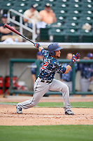 Jacksonville Jumbo Shrimp center fielder Yefri Perez (12) follows through on a swing during a game against the Birmingham Barons on April 24, 2017 at Regions Field in Birmingham, Alabama.  Jacksonville defeated Birmingham 4-1.  (Mike Janes/Four Seam Images)