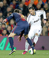 FC Barcelona's Gerard Pique (l) and Real Madrid's Cristiano Ronaldo during Copa del Rey - King's Cup semifinal second match.February 26,2013. (ALTERPHOTOS/Acero) /Nortephoto