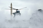 Marine One lands on a snowy South Lawn of the White House, in Washington, D.C., February 1, 2019.<br /> Credit: Martin H. Simon / CNP