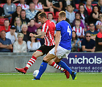 Lincoln City trialist vies for possession with Sheffield Wednesday's Joost Van Aken<br /> <br /> Photographer Chris Vaughan/CameraSport<br /> <br /> Football Pre-Season Friendly - Lincoln City v Sheffield Wednesday - Friday 13th July 2018 - Sincil Bank - Lincoln<br /> <br /> World Copyright &copy; 2018 CameraSport. All rights reserved. 43 Linden Ave. Countesthorpe. Leicester. England. LE8 5PG - Tel: +44 (0) 116 277 4147 - admin@camerasport.com - www.camerasport.com