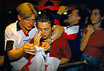 'ENGLAND'S WORLD CUP 1998', FANS WHO CANNOT BEAR TO WATCH AS ENGLAND GO OUT OF THE WORLD CUP ON PENALTIES. SPORTS CAFE, LONDON, 1998