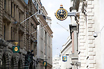 Historic clock and street signs on buildings, Lombard Street, London, England