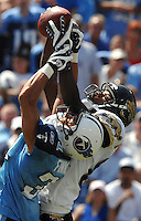 Tennessee Titans cornerback #31 Cortland Finnegan (left) steals the football from Jacksonville Jaguars receiver #84 Troy Williamson for an interception at LP Field in Nashville, TN. (The Florida Times-Union, Rick Wilson)