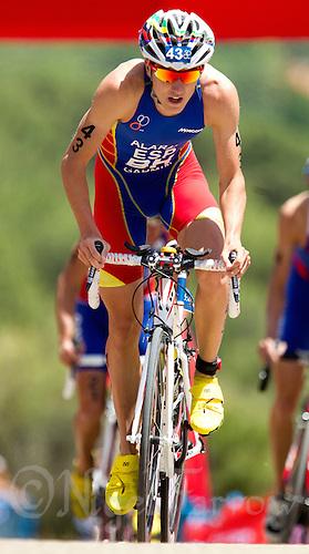 27 MAY 2012 - MADRID, ESP - Fernando Alarza (ESP) of Spain on the bike during the elite men's 2012 World Triathlon Series round in Casa de Campo, Madrid, Spain (PHOTO (C) 2012 NIGEL FARROW)