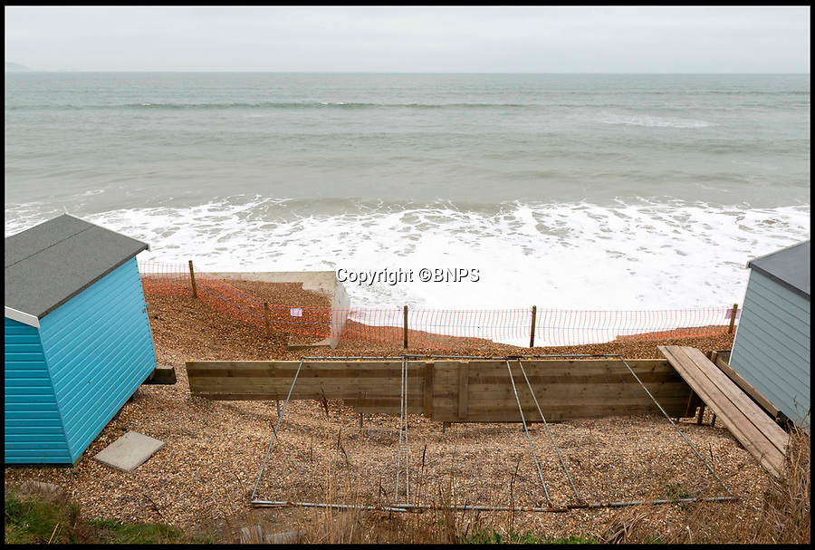 BNPS.co.uk (01202 558833)<br /> Pic:  RogerArbon/BNPS<br /> <br /> The gap where beach huts numbers 260 and 261 once stood.<br /> <br /> A group of beach hut owners have been evicted from a coastal beauty spot after a local council refused to replenish a shingle bank that washed away.<br /> <br /> Around 20 owners were last week given their marching orders from Hordle Cliff in Hants after coastal erosion left a 12ft drop outside the timber chalets.<br /> <br /> Some rent-payers were given as little seven days notice to vacate the pebble beach, condemning at estimated £1.1m worth of beach huts to destruction.