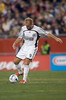 Clint Mathis passes. Clint Mathis was later ejected. NE Revolution defeat Colorado Rapids, 3-1, at Gillette Stadium on Sept. 30, 2006.