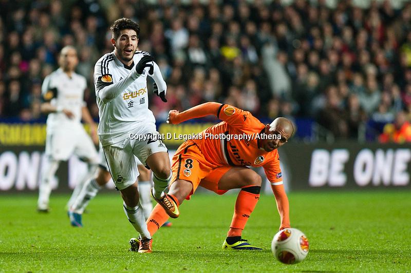 Thursday 28 November  2013  Pictured: Alejandro Pozuelo makes his way past Sofiane Feghouli of Valencia<br /> Re:UEFA Europa League, Swansea City FC vs Valencia CF  at the Liberty Staduim Swansea