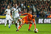 Thursday 28 November  2013  Pictured: Alejandro Pozuelo makes his way past Sofiane Feghouli of Valencia<br /> Re:UEFA Europa League, Swansea City FC vs Valencia CF  at the Liberty Staduim Swansea
