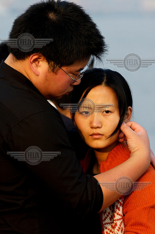 Obese youth with his girlfriend on the Bund.