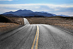 A Two Lane Blacktop Highway Running Through Death Valley National Park, California, USA