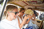 The Wedding of Poppp Delevigne and James Cook<br /> St Paul's Church, Knightsbridge 17.5.2014<br /> <br /> Sister Cara Delevigne with friends on the back of Indian style cab &quot;karma cab&quot;<br /> with bouquet