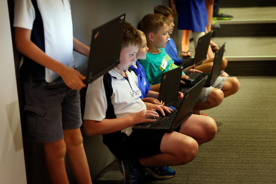 CoderDoJo, a volunteer led coding club for kids where they learn to code. One of the WA chapters is held at Woodsides' Perth HQ. Attendees wait for their turn to present their work to the club at the end of the coding session. photo by Trevor Collens 8/12/2016