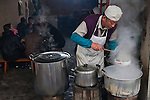 Dishing up steaming soup for lunch, Yuanyang, China