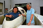 "A young Mark Evans and an equally younger Ron Jones senior at the Jones shop posing with one of Ron's latest designs. Ron probably never got the credit he deserved for his design work, particularly with respect to encapsulation. While it was the Budweiser Team that was first with the ""Bubble Bud"" Ron had drawings of fully encapsulated unlimiteds probably 15 or 20 years before anyone in the sport even thought of such thing. I only remember Bud owner Bernie little cackling ""My driver will NEVER sit in a boat with an enclosed cockpit."" I am sure that there are other design areas where the man was way ahead of his time that I am not even aware."
