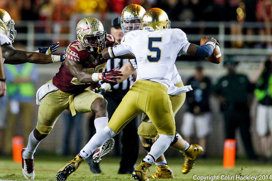 TALLAHASSEE, FLA. 10/18/14-FSU-ND101814CH-Florida State's Nate Andrews rushes Notre Dame's Everett Golson during second first half action Saturday at Doak Campbell Stadium in Tallahassee. The Seminoles beat the Fighting Irish 31-27.<br /> COLIN HACKLEY PHOTO
