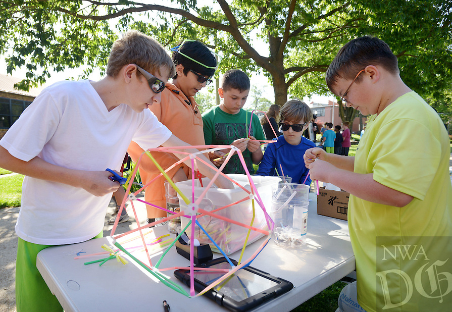 NWA Democrat-Gazette/BEN GOFF @NWABENGOFF<br /> Students tinker with drinking straws and die-cut recycled plastic on Friday April 22, 2016 at the Strawbees Tinker Club table during the Old High Middle School Earth Day Fair at the school in Bentonville.