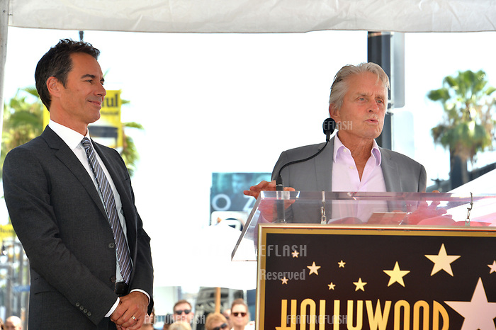 "LOS ANGELES, CA. September 13, 2018: Eric McCormack & Michael Douglas at the Hollywood Walk of Fame Star Ceremony honoring ""Will & Grace"" star Eric McCormack."