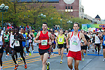 Photograph of the start of the Quad Cities Marathon 2010. An elite field of runners.