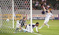 CARSON, CA - May 19, 2012: Real Salt Lake forward Robbie Findley (10) scores a goal during the Chivas USA vs Real Salt Lake match at the Home Depot Center in Carson, California. Real Salt Lake defender Nat Borchers (6) celebrates. Final score, Chivas USA 1, Real Salt Lake 4.