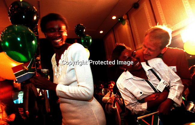 POELE9440030.Politics. Elections. ANC supporters celebrating the election victory in the first democratic election February 27 1994 in South Africa. They celebrated at Carlton Hotel in central Johannesburg, South Africa in early May-1994. party, mix race.©Per-Anders Pettersson@iAfrika Photos