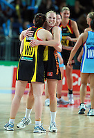 28.06.2010 Magic's Laura Langman and Jade Clarke after the ANZ Champs Semi Final netball match between the Magic and Steel played at Vector Arena in Auckland. ©MBPHOTO/Michael Bradley