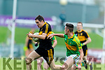 Brian Looney Dr Crokes in action against Graham O'Sullivan South Kerry in the Senior County Football Final in Austin Stack Park on Sunday