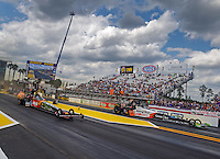 Mar 20, 2016; Gainesville, FL, USA; NHRA top fuel driver Terry McMillen (left) against Clay Millican during the Gatornationals at Auto Plus Raceway at Gainesville. Mandatory Credit: Mark J. Rebilas-USA TODAY Sports