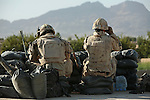 Canadian soldiers with the Royal 22nd Regiment stand watch at an outpost they have just set up in the village of Zalakhan in Kandahar province, Afghanistan. The troops moved into the village to stop Taliban fighters from firing mortars at a nearby camp that had been taking fire on an almost daily basis. Aug. 6, 2009. DREW BROWN/STARS AND STRIPES