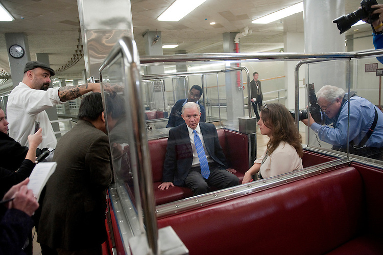 UNITED STATES - NOVEMBER 13: Sen. Jeff Sessions, R-Ala., is interviewed by the press in the Senate subway. Speculation is rampant about cabinet changes and the ongoing Petraeus scandal. (Photo by Chris Maddaloni/CQ Roll Call)