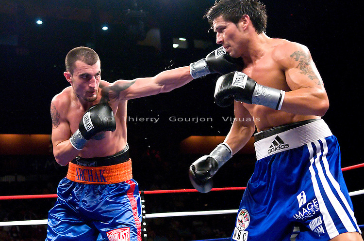 Uncasville, CT - June 7th, 2008: Archak Termeliksetian on the attack against Sergio Martinez (blue/white trunk) during their 8 rounds Super Welterweight fight at the Mohegan Sun Casino. Martinez won by tko in the 7th round. Photo by Thierry Gourjon.