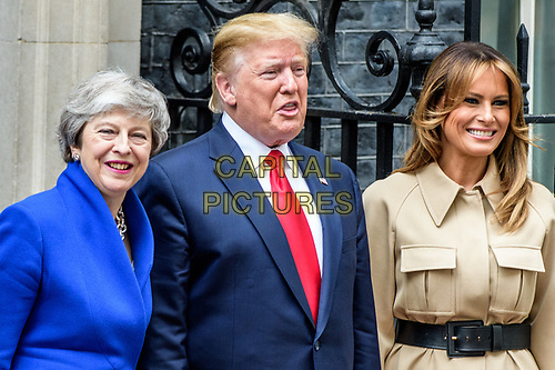 LONDON, ENGLAND - JUNE 04: Prime Minister Theresa May welcomes US President Donald Trump and First Lady Melania Trump to 10 Downing Street, during the second day of his State Visit on June 4, 2019 in London, England. <br /> CAP/CAM<br /> ©Andre Camara/Capital Pictures