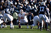 STATE COLLEGE, PA - NOVEMBER 10: Wisconsin C Tyler Biadasz (61) points out a defender while calling out pre-snap assignments. The Penn State Nittany Lions vs. the Wisconsin Badgers on November 10, 2018 at Beaver Stadium in State College, PA. (Photo by Randy Litzinger/Icon Sportswire)