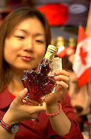 June 16 , 2002, Montreal, Quebec, Canada<br /> <br /> A Japanese tourist look at Canadian Maple Syrup in a Old Montrealsouvenir  shop, June 16 , 2002.<br /> <br /> Model released for all usages.<br /> <br /> Mandatory Credit: Photo by Pierre Roussel- Images Distribution. (©) Copyright 2002 by Pierre Roussel <br /> <br /> NOTE Nikon D-1 jpeg opened with Qimage icc profile, saved in Adobe 1998 RGB. Original size - uncropped TIFF file available on request.