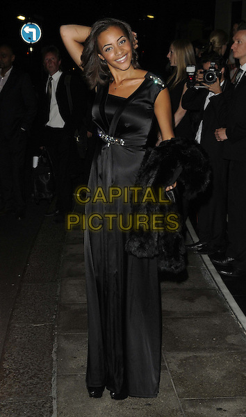 Amal Fashanu.The Fashion for the Brave fundraising event inn aid of the British Forces Foundation & the Household Cavalry Operational Casualties Fund, Dorchester Hotel, London, England..September 20th, 2012.full length black silk satin dress hand arm.CAP/CAN.©Can Nguyen/Capital Pictures.