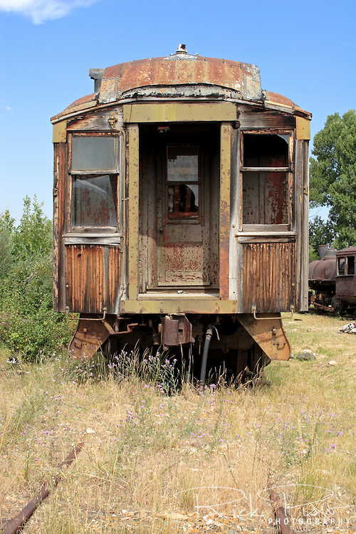 Vintage passenger coach sits idle in the Nevada City, Montana, railroad yard.