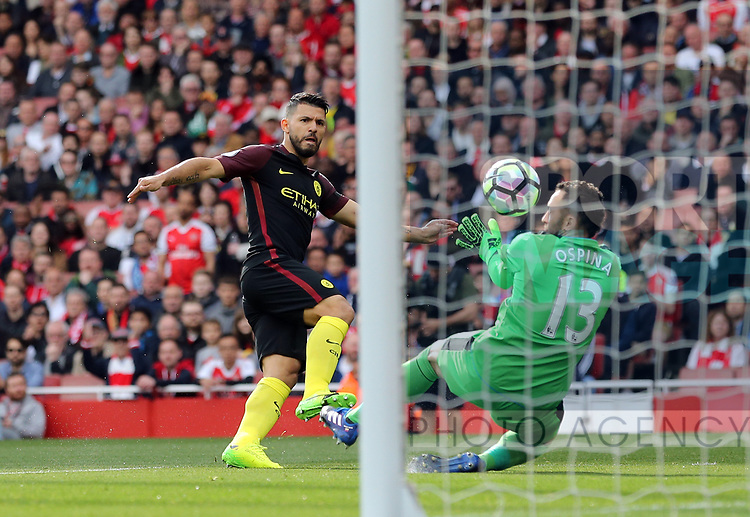 Arsenal's David Ospina saves from Manchester City's Sergio Aguero during the Premier League match at the Emirates Stadium, London. Picture date: April 2nd, 2017. Pic credit should read: David Klein/Sportimage