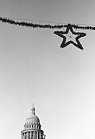 The capitol building for Texas and the single star is a visual representation for Texas, which has the motto The Lone Star State. Austin, Texas, USA, December 2003 © Stephen Blake Farrington
