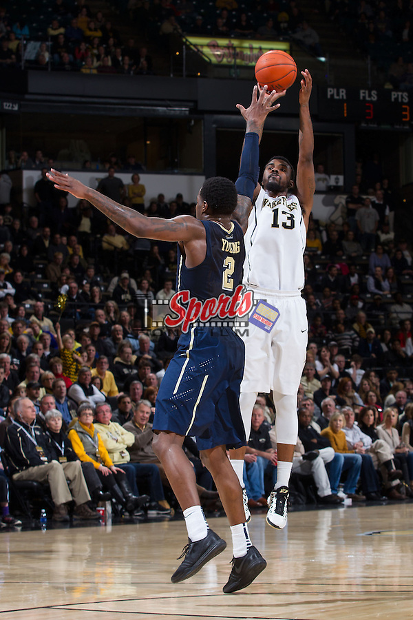 Darius Leonard (13) of the Wake Forest Demon Deacons shoots over Michael Young (2) of the Pittsburgh Panthers during second half action at the LJVM Coliseum on March 1, 2015 in Winston-Salem, North Carolina.  The Demon Deacons defeated the Panthers 69-66.  (Brian Westerholt/Sports On Film)